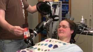 One Giant Bite: Woman with Quadriplegia Feeds Herself Chocolate Using Mind-Controlled Robot Arm thumbnail