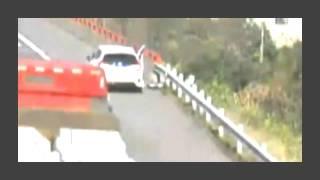 Man on shoulder hit off road by rolling wheel falling off truck