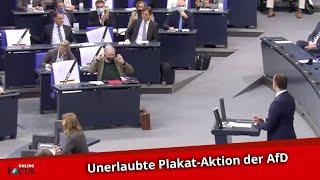 Jens Spahn setzt im Bundestag zu Rede an - AfD holt plötzlich Plakate hervor