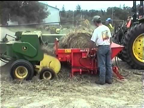 The St George Company - Round Bale Unwinder Re-baling Hay With A John Deere 336 Baler