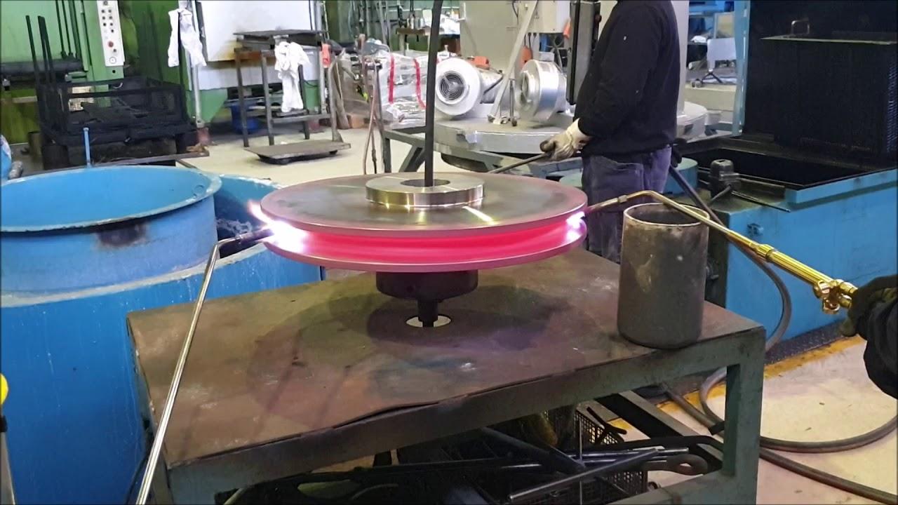 Flamhärdning av travershjul