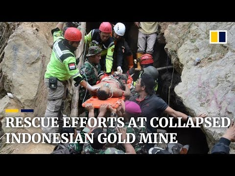 Frantic search for survivors at collapsed Indonesian gold mine