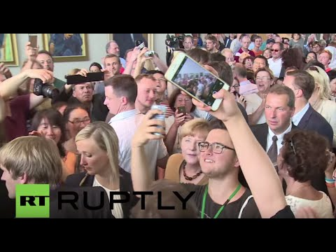 Germany: Merkel signs autographs at German Chancellery open day