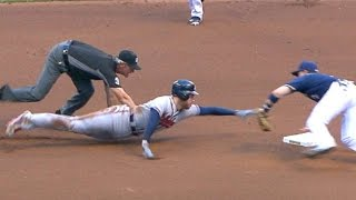 Freeman overslides bag, somehow avoids tag