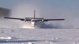 Twin Otter landing frozen lake with wheel-skis