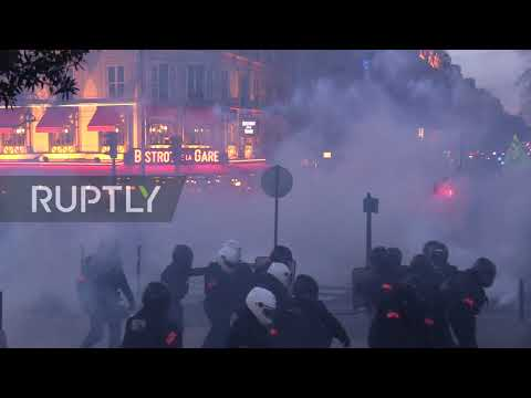 "France: Tear gas billows in streets of Paris at ""Yellow Vests"" protest"