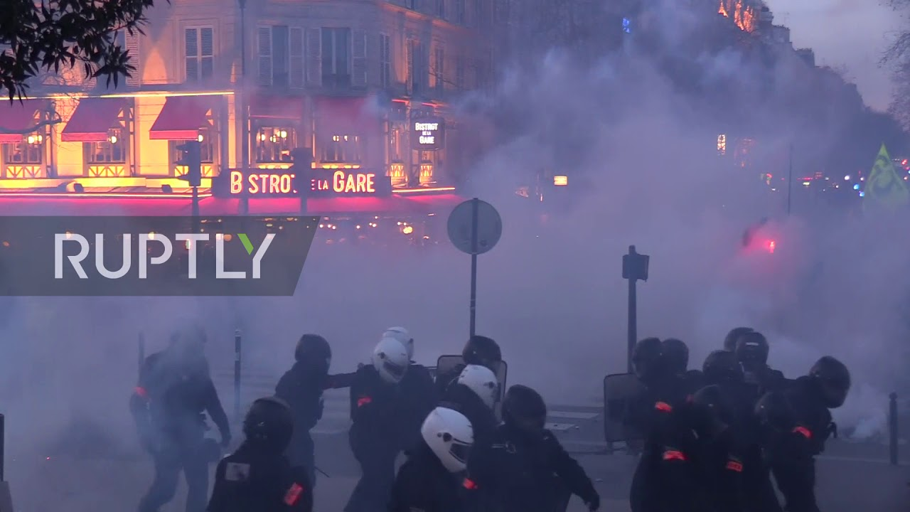 "France: Tear gas billows in streets of Paris at ""Yellow Vests"" protest - RUPTLY"
