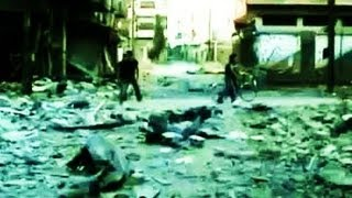 Война в Сирии. 6 июля 2013. Разрушения в результате авиабомбежек провинции Хомс...