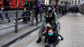 Violence erupts as Hong Kong police crack down on protesters