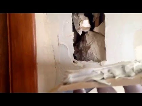Fixing Sheetrock holes with a California patch