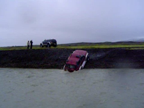 44 inch Nissan Patrol crossing a glacial river in Iceland