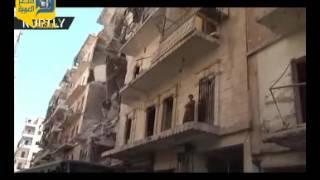 شاهد.. سكان حي صلاح الدين في حلب يغادرون منازلهم عبر ممرات إنسانية
