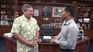 Nick Delgado talks with Eddie Calvo in his final days as Guam governor