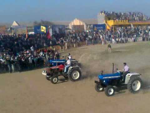 TRACTOR  race at KILA RAIPUR  BY MANJINDER GREWAL