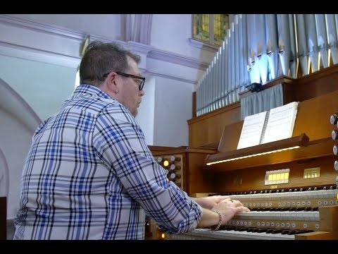 Hybrid Organ Video: Gregory M. Lesko plays: 'God of Day and God of Darkness' by Marty Haugen.