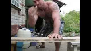 Russian man hammers nails with hand