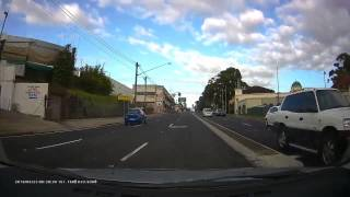 Blue Toyota Yaris running the red light