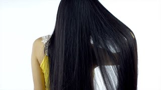 Back view shot of a young girl showing off her long black hair - Indian beauty