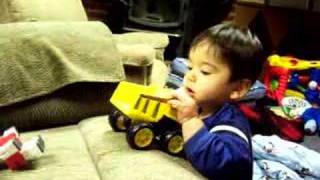 Henry plays with his dumptruck