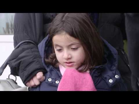 Sarah Wayne Callies talks to refugees at the border of Serbia