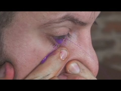 Painter snorts paint and sprays onto canvas through his eye