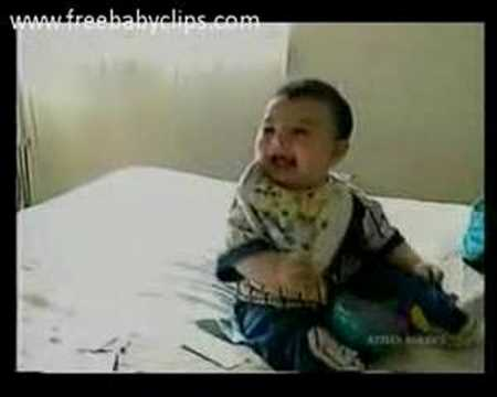 Laughing Baby Falls Over From Laughing