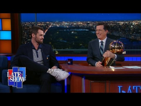 Kevin Love Shows Off NBA Championship Trophy