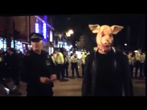 Simon Elmer of Architects for Social Housing wears a Pig Head Mask during Cereal Killer Cafe Attack.