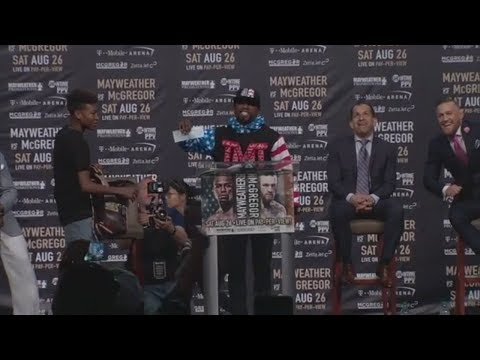 Floyd Mayweather Busts Out $100 Million Check During Presser With Conor McGregor | ESPN