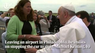 Pope stops car to bless child in wheelchair