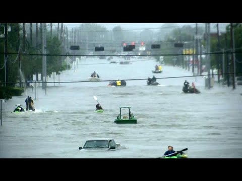 Floods surge in Houston as water flows from reservoirs