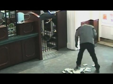 Bank robbery fail: Suspect drops thousands of dollars in bank and gets caught