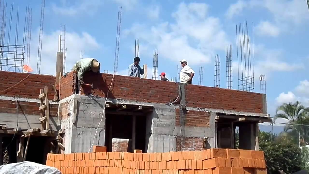Fachada de casa en construcci n con muros de tabique rojo - Construccion de chimeneas de ladrillo ...