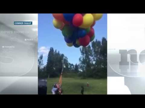 Up in the air: Calgary man soars in lawn chair attached to helium balloons