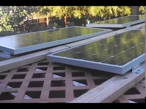 Six Renogy RNG-100D solar panels mounted on backyard pergola. MPPT solar  charge controller - Six Renogy RNG-100D Solar Panels Mounted On Backyard Pergola. MPPT
