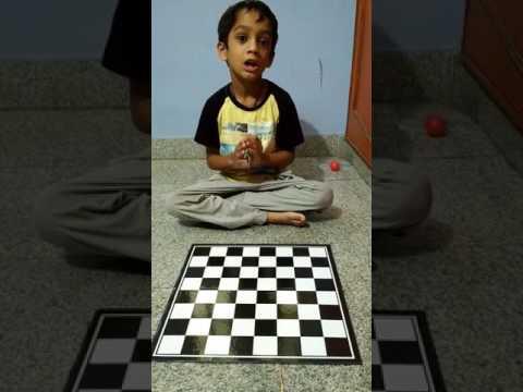 Varaynya arranging the chess coins
