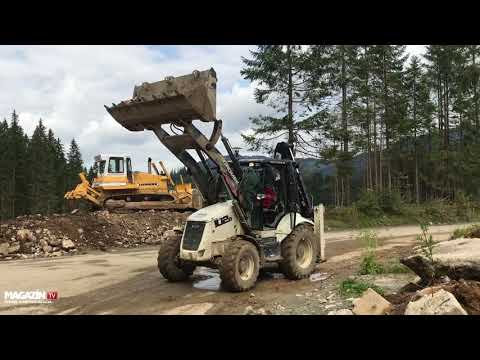 backhoe loader HIDROMEK HMK 102B loading clay to TATRA dump truck