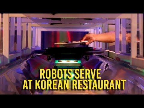 Robots bring the food at Korean barbecue restaurant