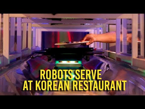 Robots bring the food at Korean barbecue restaurant
