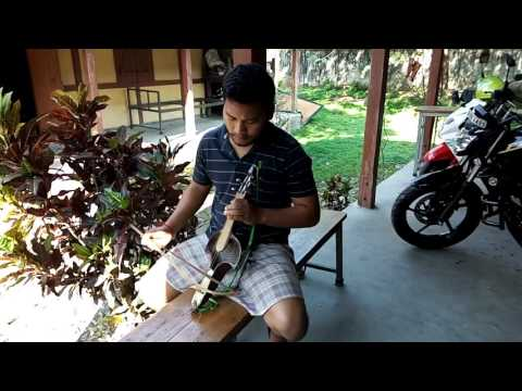 Dwihung Brahma playing Traditional Musical instrument of the Bodos