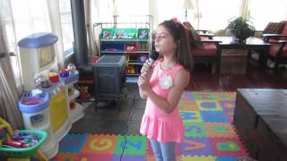 My 7 year old singing karaoke to 'How far I'll go'.