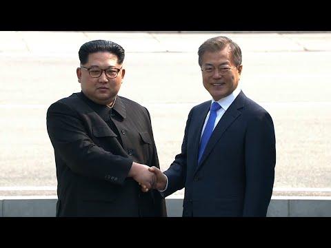 North and South Korean leaders shake hands at the border