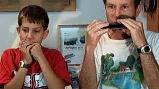 Kiss the blarney stone -10 years kid -pleying harmonica