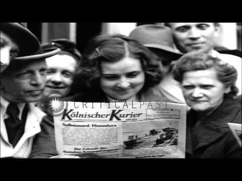 German people read newspaper Kolnischer Kurier distributed by SHAEF in Cologne Ge...HD Stock Footage