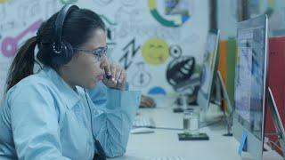 Smart female support / call center operator speaking to customer