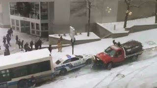 Cars & Buses Sliding Down and Crashing from a Snowy Slipery Slope - Montreal Canada