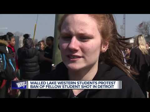 Students hold walkout protest after Walled Lake school banned teen who was shot
