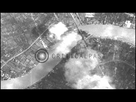 Bombing of Rama VI bridge in Bangkok,Siam by United States B-24 bomber aircraft HD Stock Footage