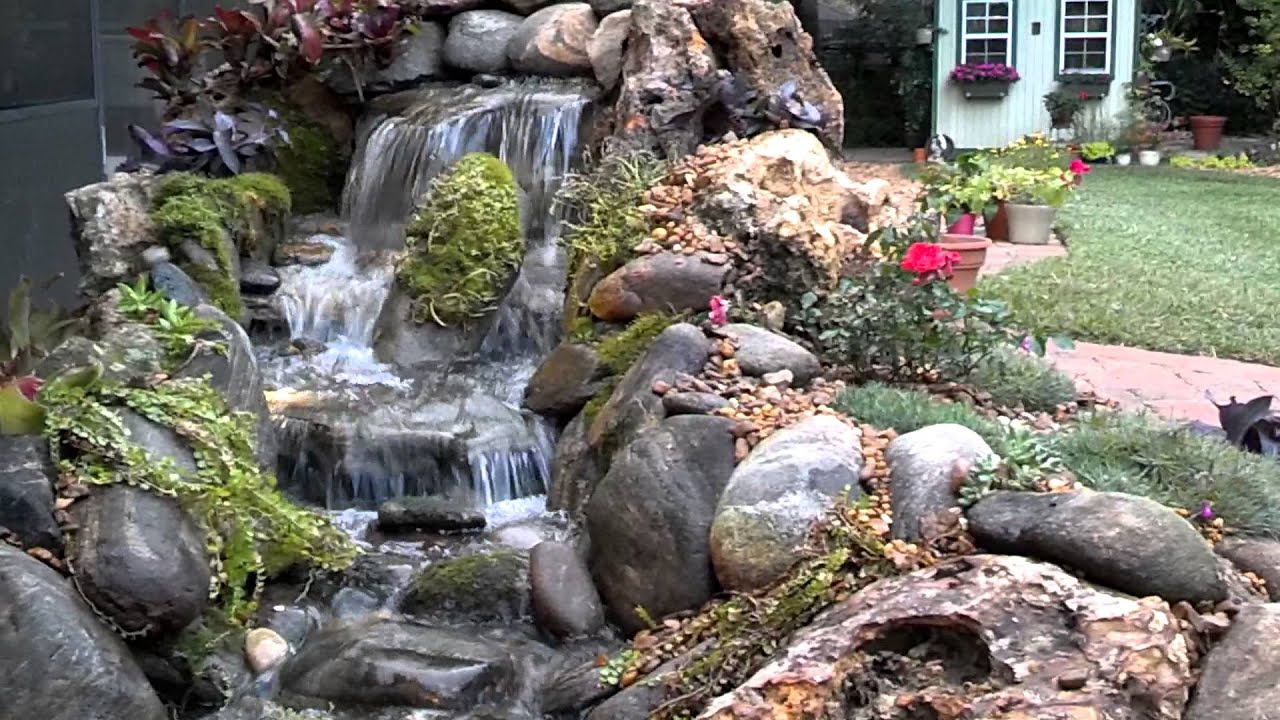 natural pondless waterfall by creative outdoor design in lady lake  florida