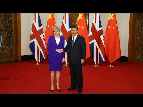 President Xi meets British PM Theresa May in Beijing